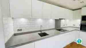Kitchen splash back with white bevelled metro tiles.