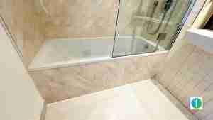 Bathtub walls renew with shower panels.